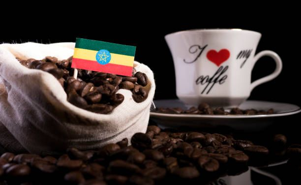 ethiopian flag in a bag with coffee beans isolated on black