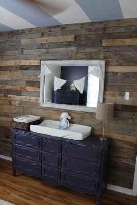 Love the pallet wall, colored dresser and striped ceiling.
