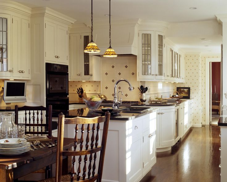 Custom kitchen:curved leaded glass cabinets:Tiffany pendamts