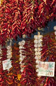 Strings of dried peppers, for paprika, cover entire walls at the Central Market in Budapest. - See more at: http://travelcuriousoften.com/october13-feature.php#sthash.MFiNEcjz.dpuf
