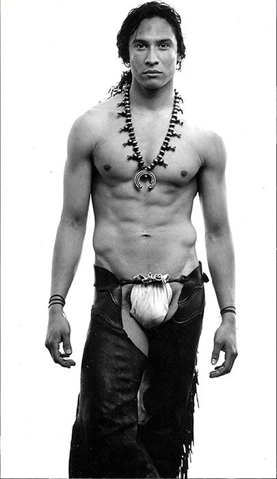 """Native American...Even men can do it. Hypersexualizing and exploiting the Dine culture with the use of the squash blossom necklace and """"cowboy"""" pants. This would be a debatable for some, due to the fact that the necklace is worn both inside and outside of ceremony & by Medicine Men. Who knows...maybe he is one. But...I don't think he would be going to help anyone heal dressed this way. :/ Um, So, if this was a N8TV Woman with the same, I wouldn't think twice, so, he belongs on the board."""