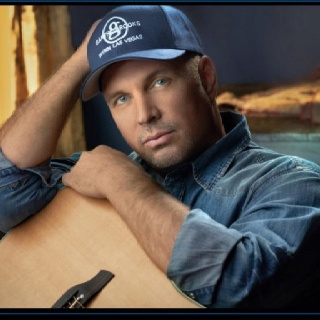 Garth Brooks - Saw him at about the time No Fences was released it was an amazing show.  I stood on my chair the whole show because all those crazy women rushed the stage.