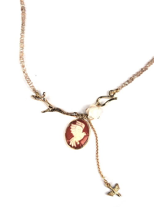Necklace made of fairtrade gold with hand cut bird cameo and spinel.