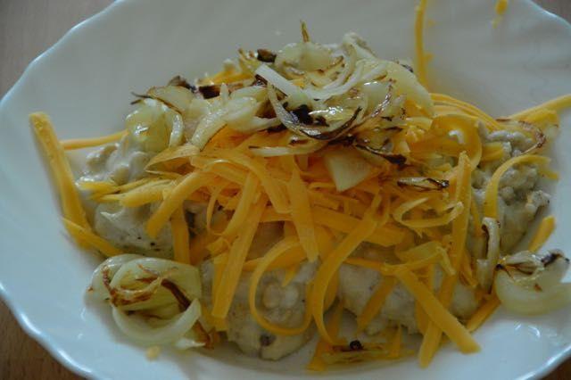 Buckwheat dumplings with cashew cheese sauce, onions, vegan cheddar style cheese!