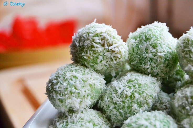 Klepon...this is Indonesian food..the ball made of glutinous rice flour it contains palm sugar inside sprinkled with shredded coconut ....