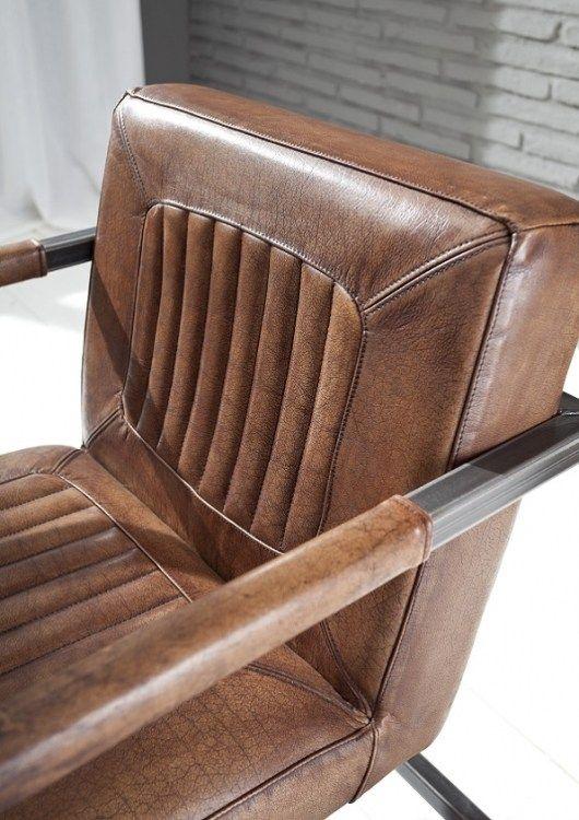Büffelleder Schwingsessel Jenson im Industriestil mit Vintage Büffelleder Bezug.
