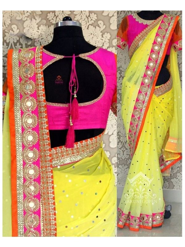 Gorgeous Yellow Georgette Designer Saree with Pink Color Row Silk Blouse. It Contained the work of Zari, Embroidery with Lace Border. The Blouse can be customized up to bust size 44