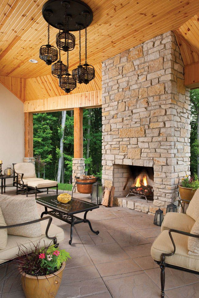 Outdoor fireplace adds warmth to a covered porch outdoor for Covered porch with fireplace