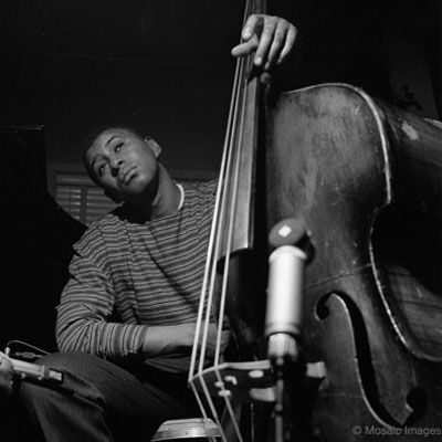 The great Paul Chambers between takes at a Blue Note recording session. Photo by F. Wolff