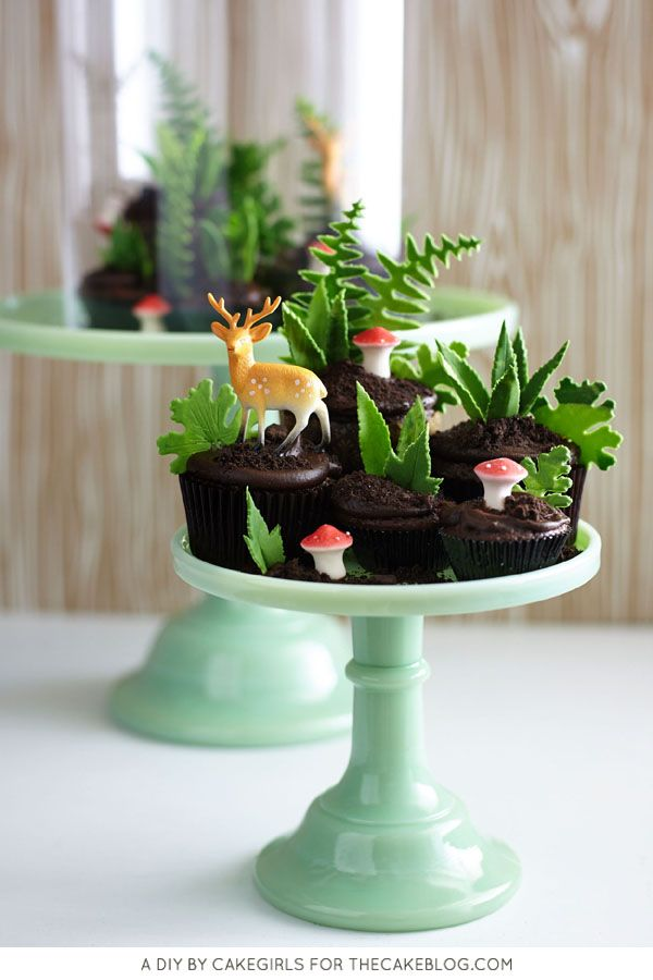 DIY Cupcake Terrarium!  I love how an entire woodland scene is being created by a collection of cupcakes.