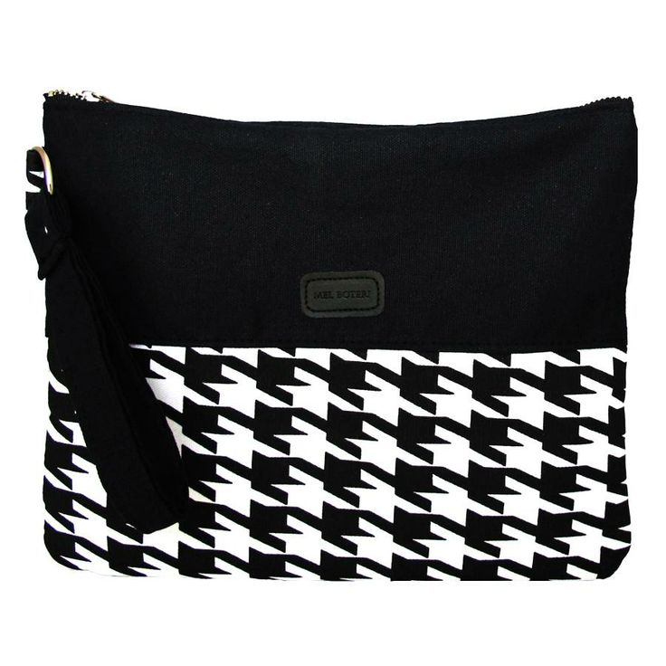 A triple threat, this black and white houndstooth bag functions as a wristlet clutch, tablet case, or extra pouch to org