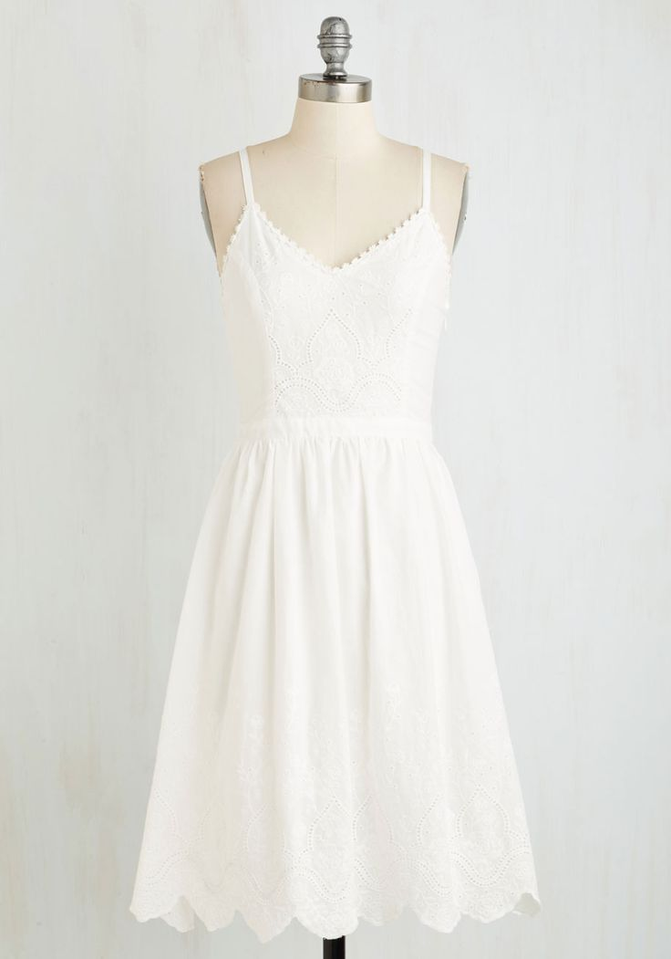 Your friendly vibes are in felt in full force when you show a smile and sashay in this adorable eyeleted sundress! With a daisy-trimmed neckline and subtly swirling floral embroidery at the bodice and hemline, this LWD encapsulates the charms of your character.