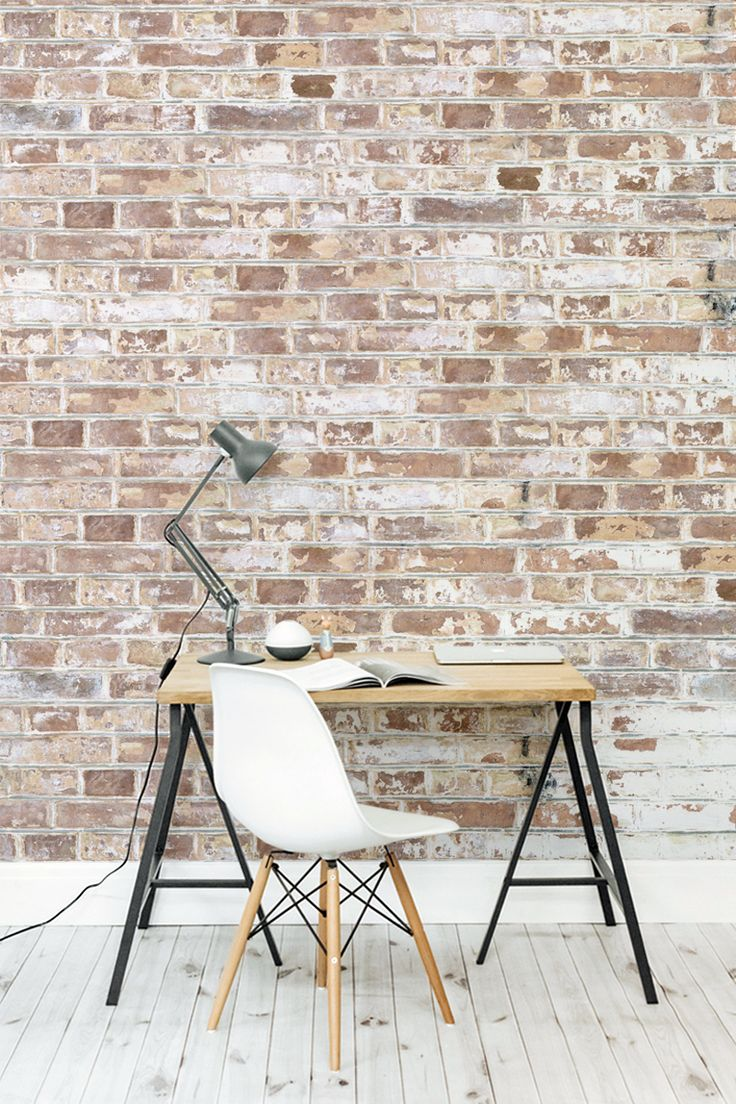 Love the clean and minimal look of Scandi interiors? This white paint brick wallpaper marries stripped back elegance with industrial design. It's ideal for contemporary living room spaces, or inspiring desk spaces. The only thing missing is a faux sheepskin fur draped over the chair!