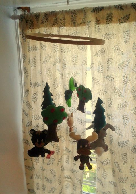 North Grenville Cooperative Preschool and Learning Centre- Made entirely by the educators in this infant program, this mobile made of hanging felt figures, adds a beautiful, nature-inspired invitation for infants to discover.