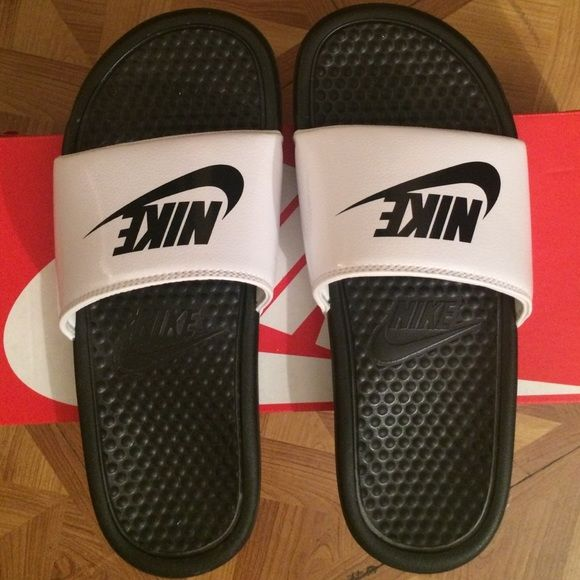 Nike Sliders Classic White and Black Nike Slippers. Used but in great condition NO TRADES only selling. Womens 7 Nike Shoes Slippers