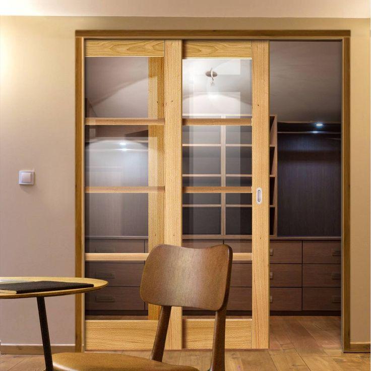 Twin Telescopic Pocket Oslo 4L Oak Veneer Doors - Clear Flat Glass - Prefinished.    #pocketdoor  #interiordesign  #oakdoor  #telescopicdoors