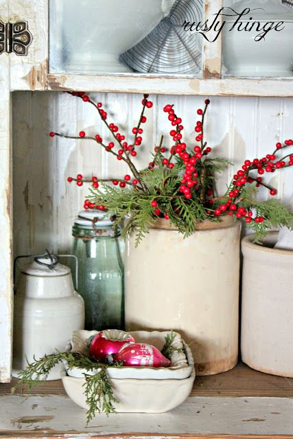 Christmas Decorating: Pretty Christmas touches to the crocks.