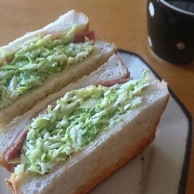 "沼サン Sandwich in ""Numa family"" style bacon, cheese, shredded cabbage, avocado, olive, pickles, mayo and mustard"