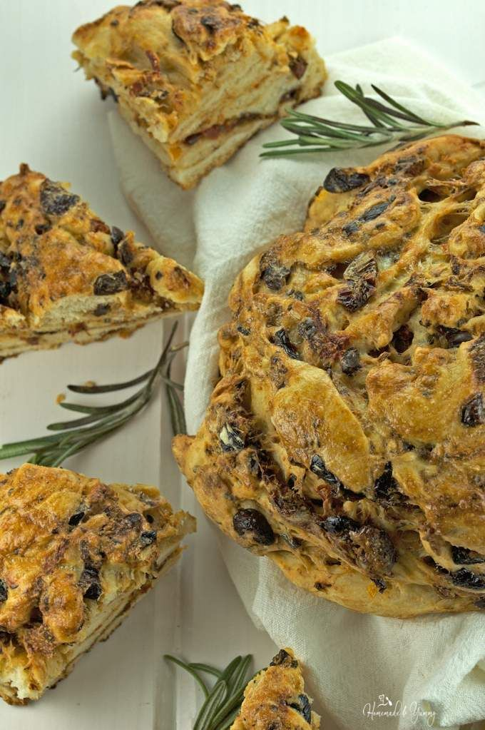 Black Olive & Tomato Bread is full of savoury flavour packed with pieces of olives and sun-dried tomatoes.   homemadeandyummy.com