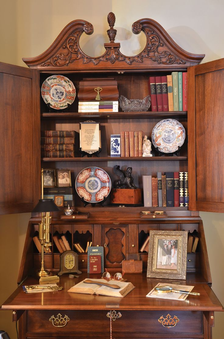 A black walnut secretary showcases keepsakes.