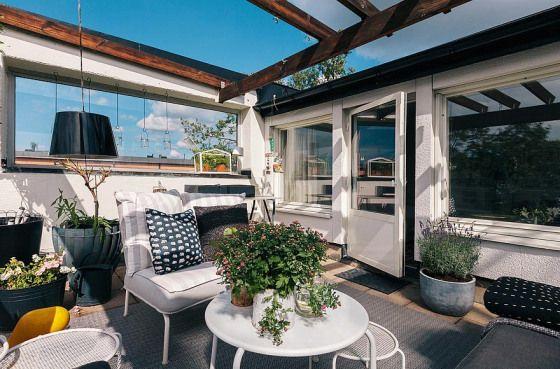 Un petit coin de paradis sur une terrasse d'immeuble | Mármol de Carrara - Delikatissen