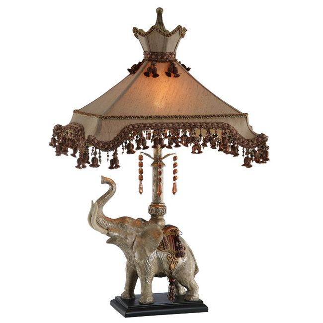 This elephant lamp with beaded shade offers a unique look that is a guaranteed conversation-starter. This table lamp features a gold finish on the fixture and a luxurious rectangular shade that is accented with elegant beaded tassels.