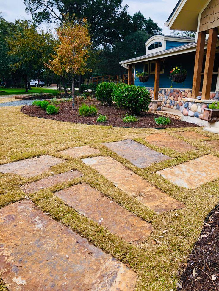 Custom large flagstone slab walkway inset into zoysia