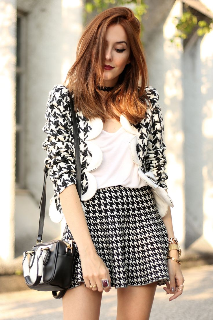 This look is all about pied de poule & pied de coq, a classic print in different sizes black and white. Wearing a gorgeous coat and skirt with white heels.