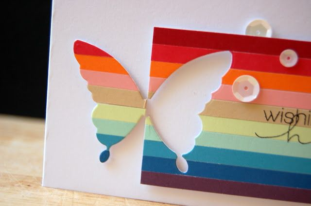 handmade greeting card: Half striped Chrissy butterfly  ... panel of colored strips in rainbow color order ... die cut butterfly with half as negative space at the edge of the panel and the other half cut from strips of the paper ,,, great desgin!!