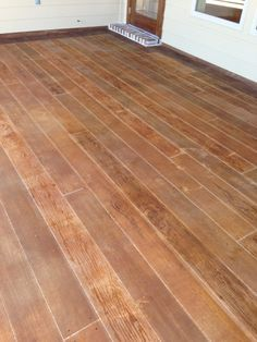 I REALLY like the wood looking painted/stained concrete.  Would like to do this if it's not too hard