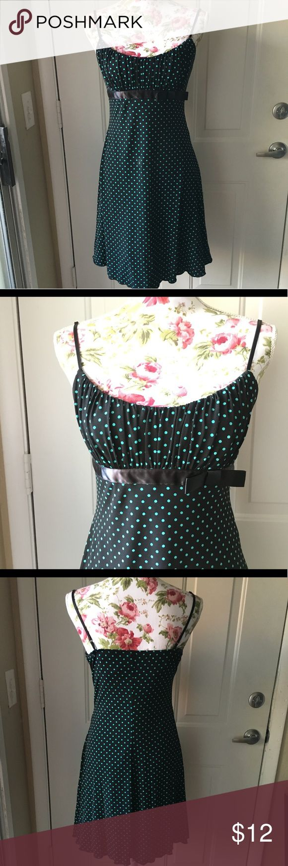 """Teal + Black Polka Dot Dress Teal and black polka dot formal dress with underbust bow and tulle underneath. Adorable and very comfy! In great condition! Tag says it's a junior's large, but fits much more like a medium. Brand is """"Love Tease."""" Selling because I never wear it and it's no longer my style Bonton Dresses"""