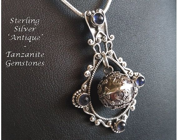 Unique Harmony Ball Necklace / Bola Necklace with Four Tanzanite Gemstones on an Antique Sterling Silver pendant - found at https://www.etsy.com/shop/HarmonyBalls and also at www.HarmonyBallPendant.com