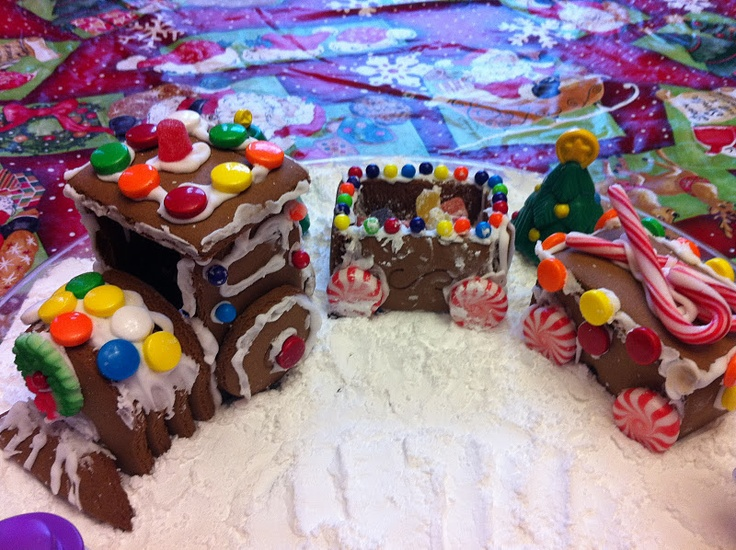My son's gingerbread train this year. Tired of doing the house every year. Nice twist! Got the kit at Walgreens. ~Julie