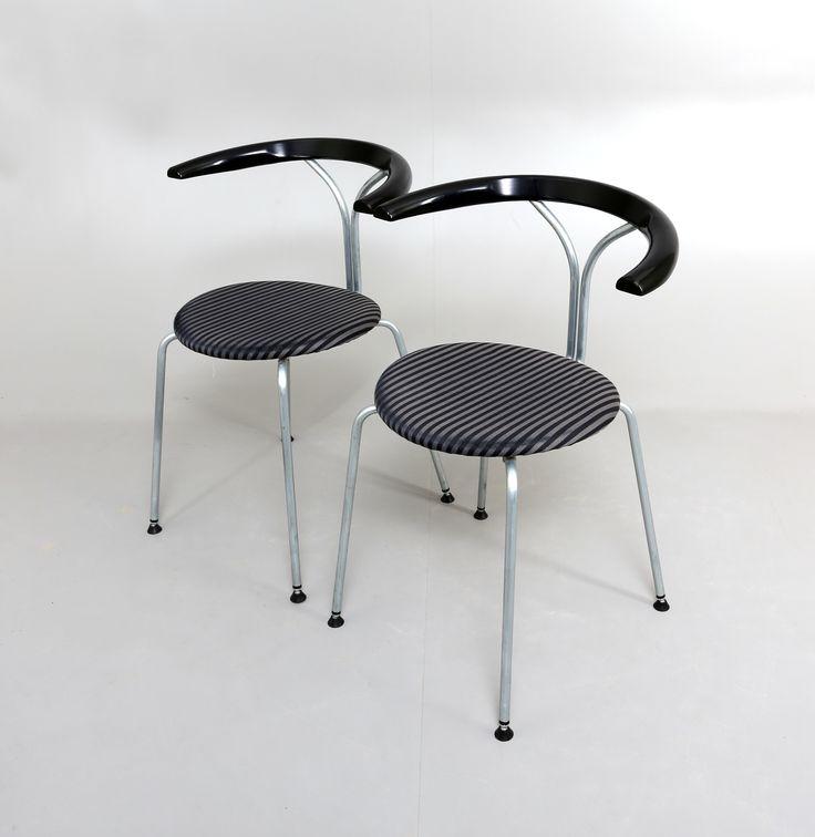 BJÖRN ALGE. Stolar, 1 par, Lindlöfs Interiör, Lammhult.  Chrome-plated metal frame. Blackened wooden frame. Upholstered seat. Both stamped Lindlöfs 1989-03. Stackable.