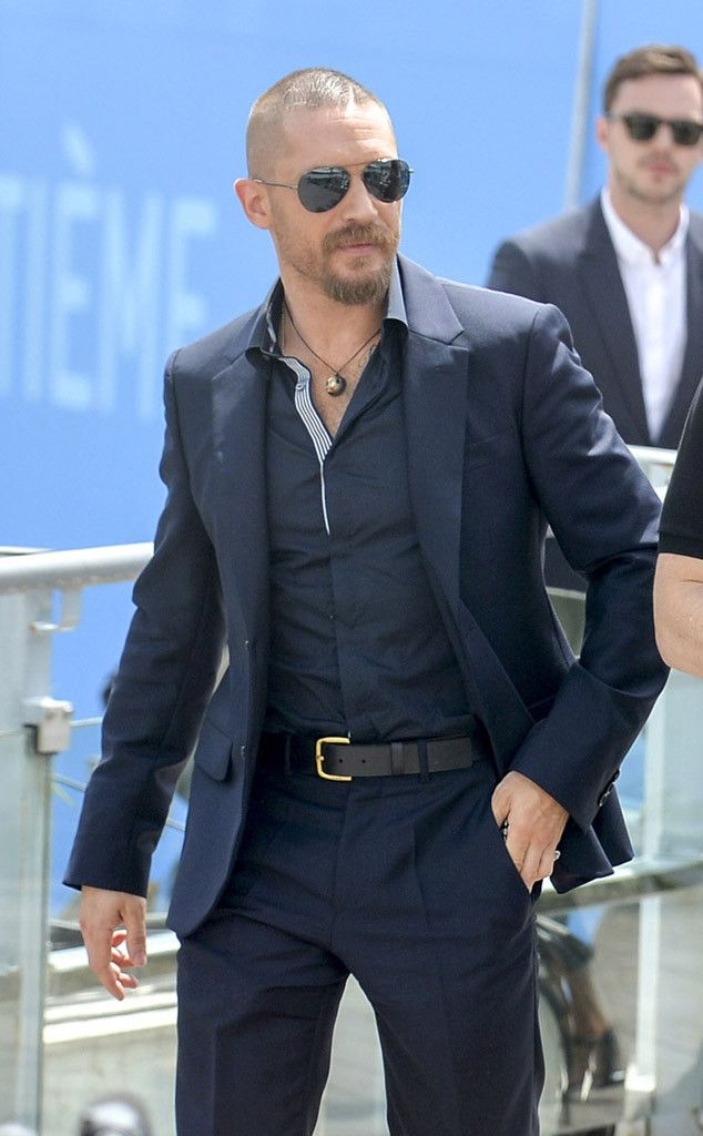 From his perfectly tailored navy suit, to his unique necklace, to his aviators with flash lenses, Tom Hardy's style is the epitome of masculine chic!