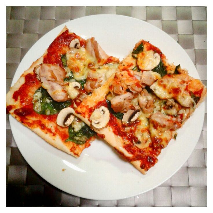 Home made pizza - chicken mushroom and spinach, topped with mozzarella