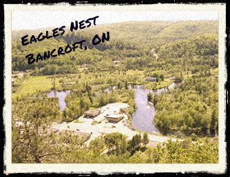Eagles Nest, located in Bancroft, ON. The view is spectacular and there are walking trails through the berry patches among the pines and other mature trees. An imposing white wood cross, erected in commemoration of Bancroft's Centennial in 1979, looks out over the town and valleys.  #outdoors #trails