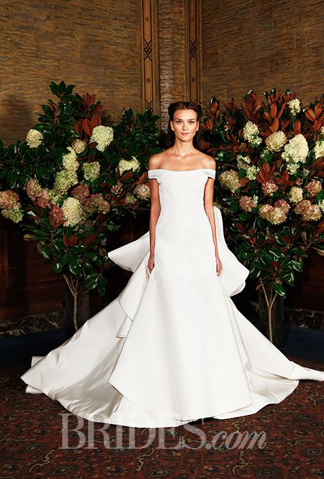 """Brides.com: . """"With a seriously dramatic ruffled back and perfectly off-the-shoulder sleeves, this Austin Scarlett dress is the definition of girly-meets-elegant. And, as a Southerner myself, I can't help but love that the collection was inspired by Scarlett O'Hara, the ultimate Southern belle."""" — Anna Olson, Editorial Assistant  Wedding dress by Austin Scarlett"""