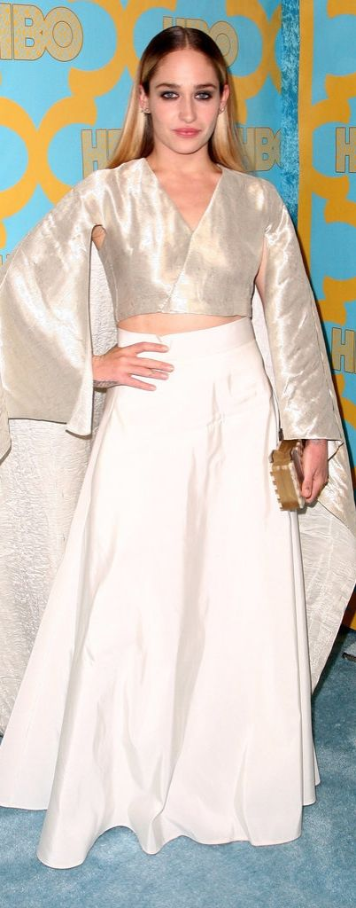 Actress Jemima Kirke was a vision of glamour in a full white skirt and silver crop top with caped sleeves at the HBO Golden Globe party.