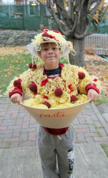 Halloween Costume that I made for my son :) knitting wool for the spaghetti, styrofoam balls covered with fluffy socks and paint for the meatbals, colander for the hat, lampshade for the bowl.