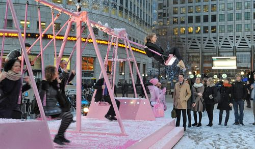 Evian activity in Canary Wharf & Finsbury Ave Square - swings that activate a snow machine - no swing, no snow!