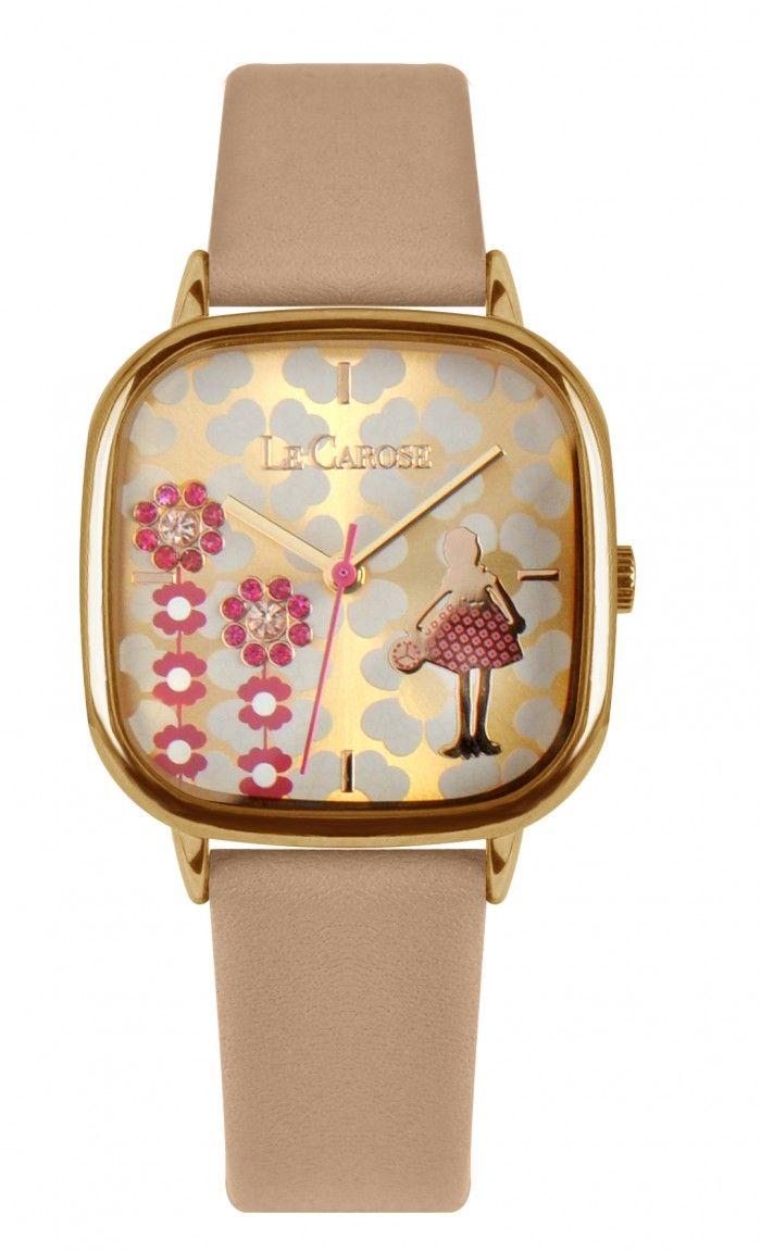 orologio con cinturino in pelle beige, cassa in ottone,retro in acciaio. quadrante con fiori incisi e appilcazioni con strass pink.