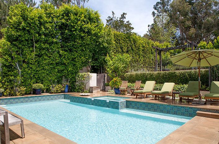 Reese Witherspoon's Home is What Backyard Dreams Are Made Of// tiled pool, lush landscaping, waterfallSwimming Pools, Reese Witherspoon, Witherspoon Brentwood, Brentwood Home Pools, Brentwood Estate, Los Angels, David Offering, Gorgeous Estate, Large Swimming