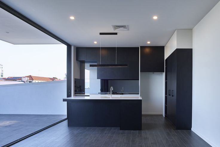 Argentum | Photography by Scott Burrows | Designed by Ellivo | www.ellivo.com | #design #architecture #balcony #blackandwhite #kitchendesign #kitchen #lighting #appliances