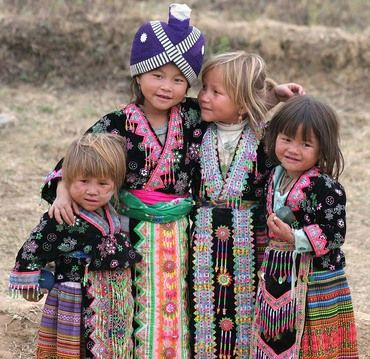 Little Girls from the Hmong people in a village north of Sam Neua in Laos. The Hmong mostly live in the highlands of southern China and northern Southeast Asia, including in Laos and Vietnam. They live primarily as self-sufficient farmers and gatherers. It is believed the Hmong may originally be from Siberia.