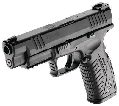 Springfield Armory XDm 9mm 4.5inch. One of the most accurate 9mm on the market. My hubby's baby!!