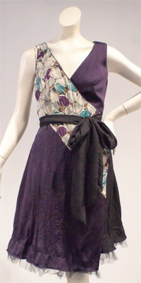 So want!  Chameleon dress that is reversible and can be worn 10 different ways.  In local boutique...but can't afford!