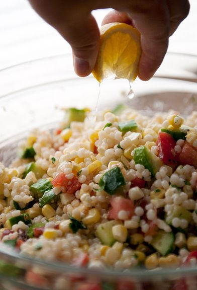 israeli couscous salad recipe 1 cup Israeli couscous 1 cob of corn veg oil 1 medium English 2 medium tomatoes 1/4-1/2 cup feta olive oil juice of 1 lemon