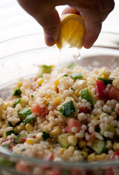 israeli couscous salad recipe 1 cup Israeli couscous 1 cob of corn veg oil 1 medium English 2 medium tomatoes 1/4-1/2 cup feta olive oil juice of 1 lemon