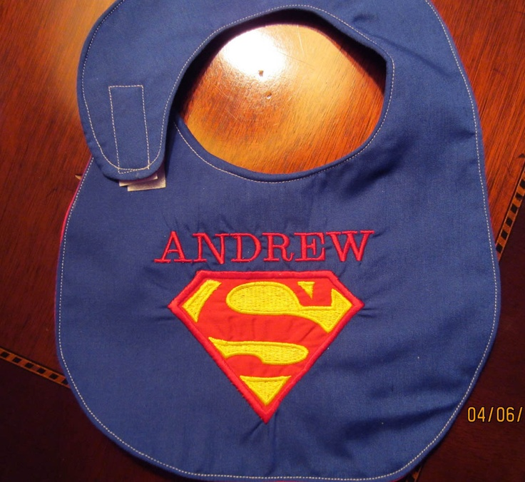 Superman Bib  with Personalized Name added..no extra charge. $12.50, via Etsy.